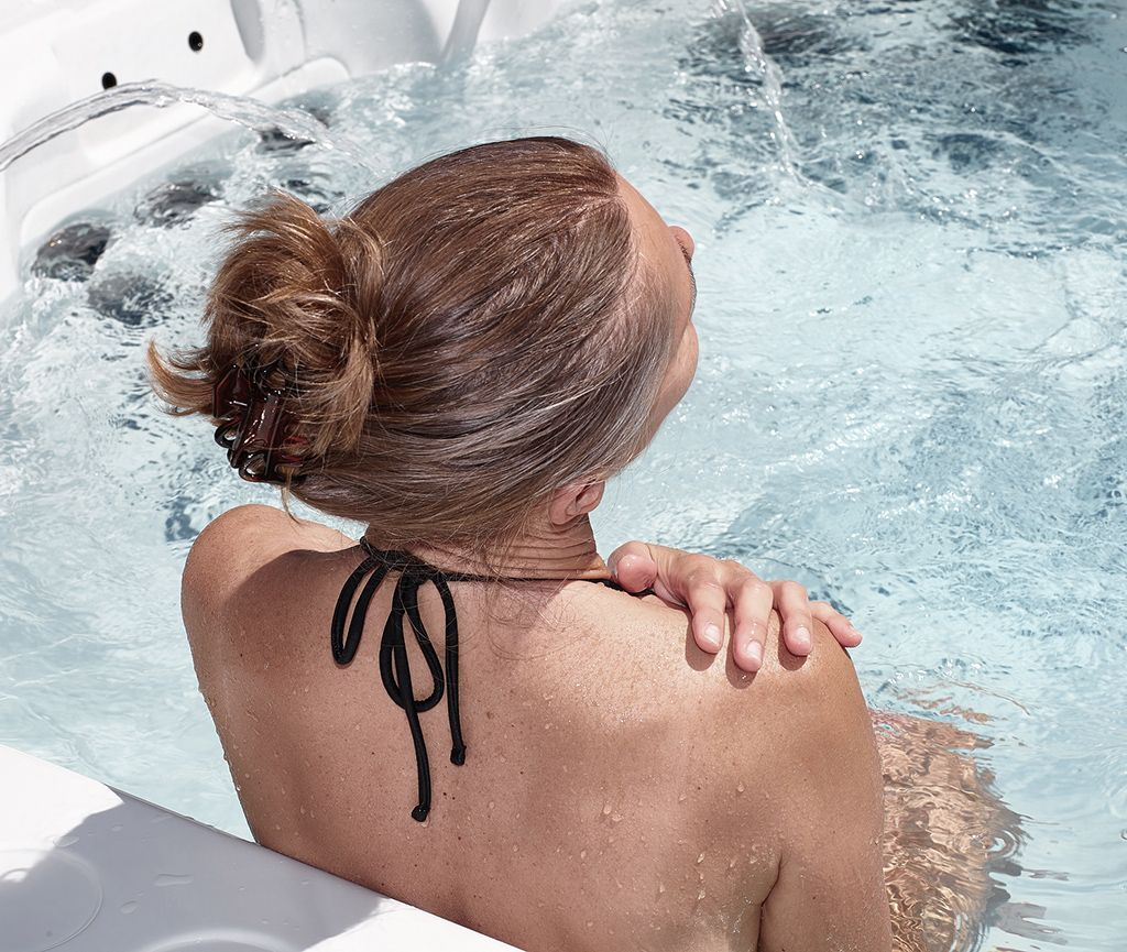Woman is relaxing in a whirlpool of the Wellness Hotel Feldrand